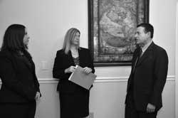 Ayo and Iken attorneys meet in hallway